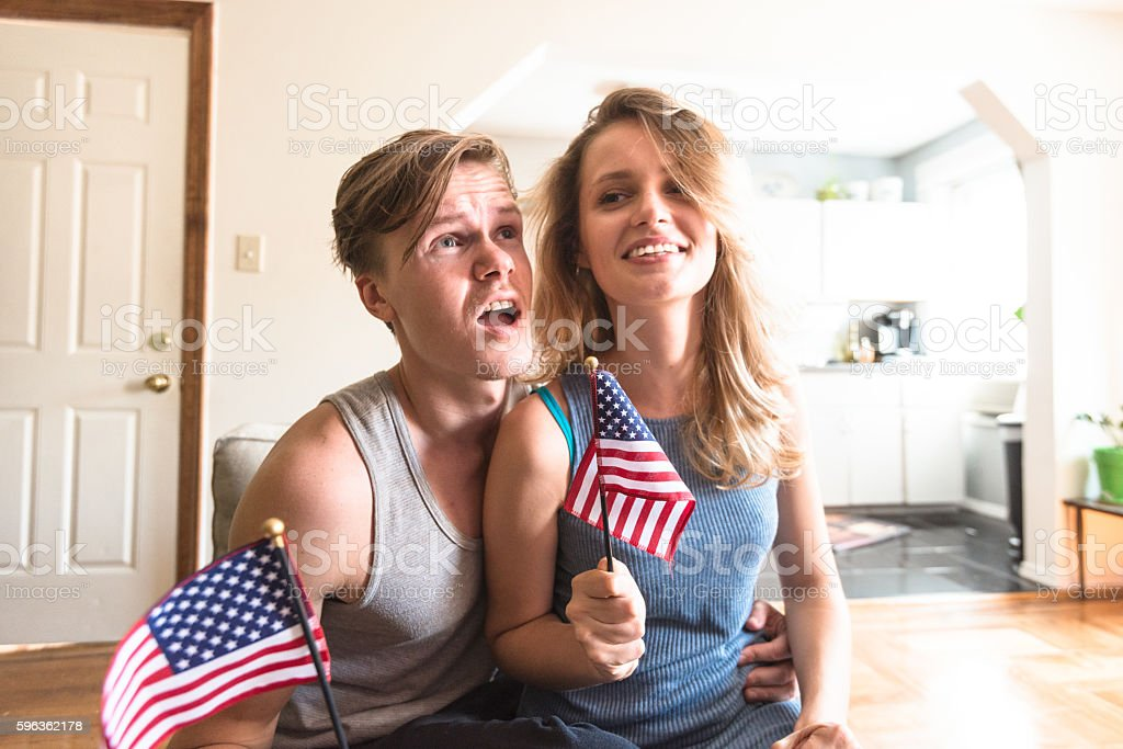 couple enjoy the national holiday in USA watching tv royalty-free stock photo