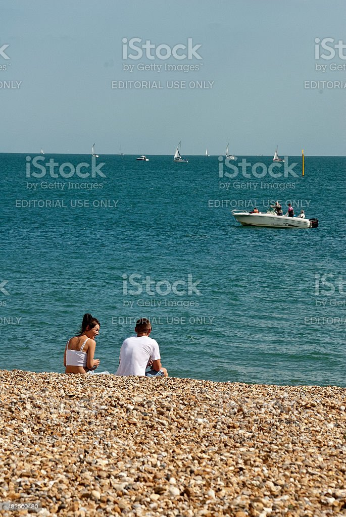 Couple enjoy the sun at the beach stock photo