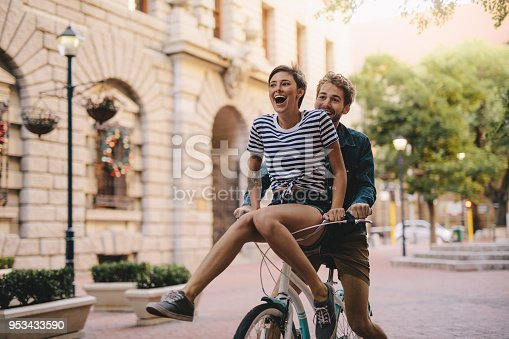istock Couple enjoying a bicycle ride in the city 953433590