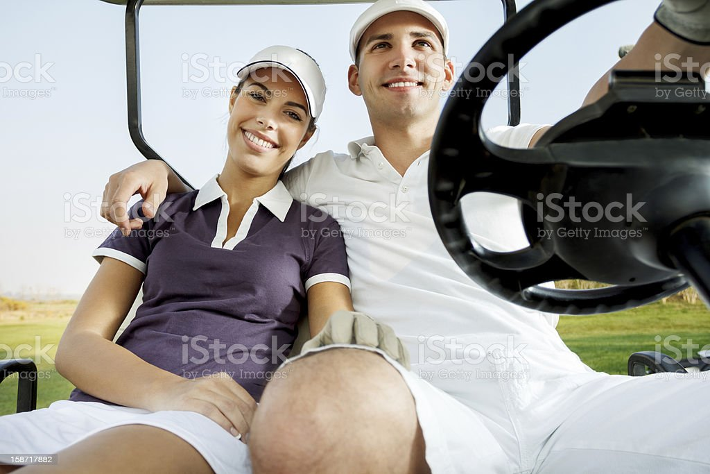 couple enjoying a game of golf royalty-free stock photo