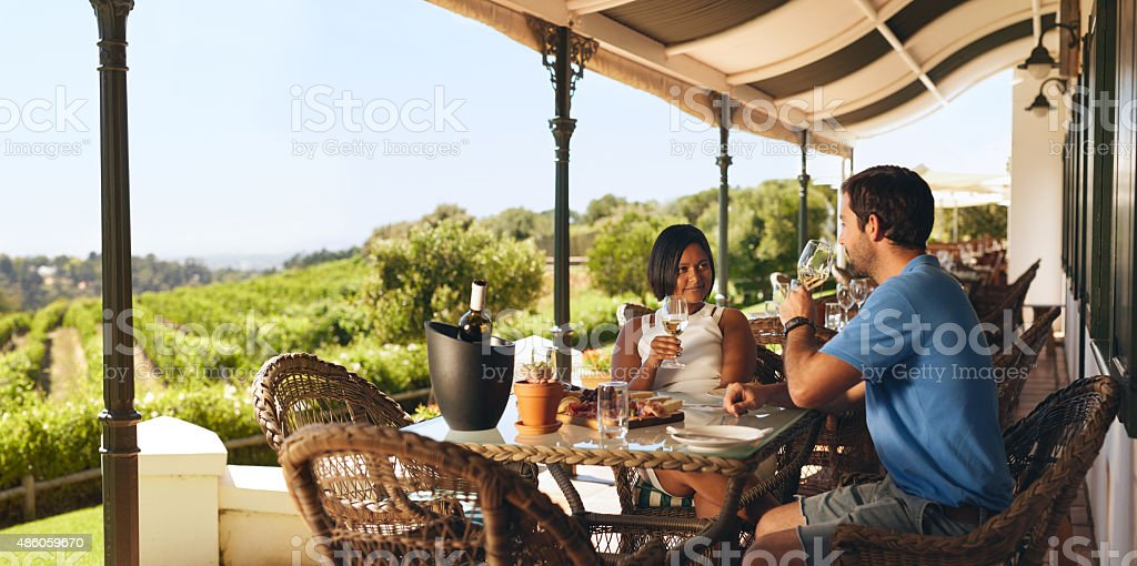 Couple enjoying a glass of wine in a winery restaurant stock photo
