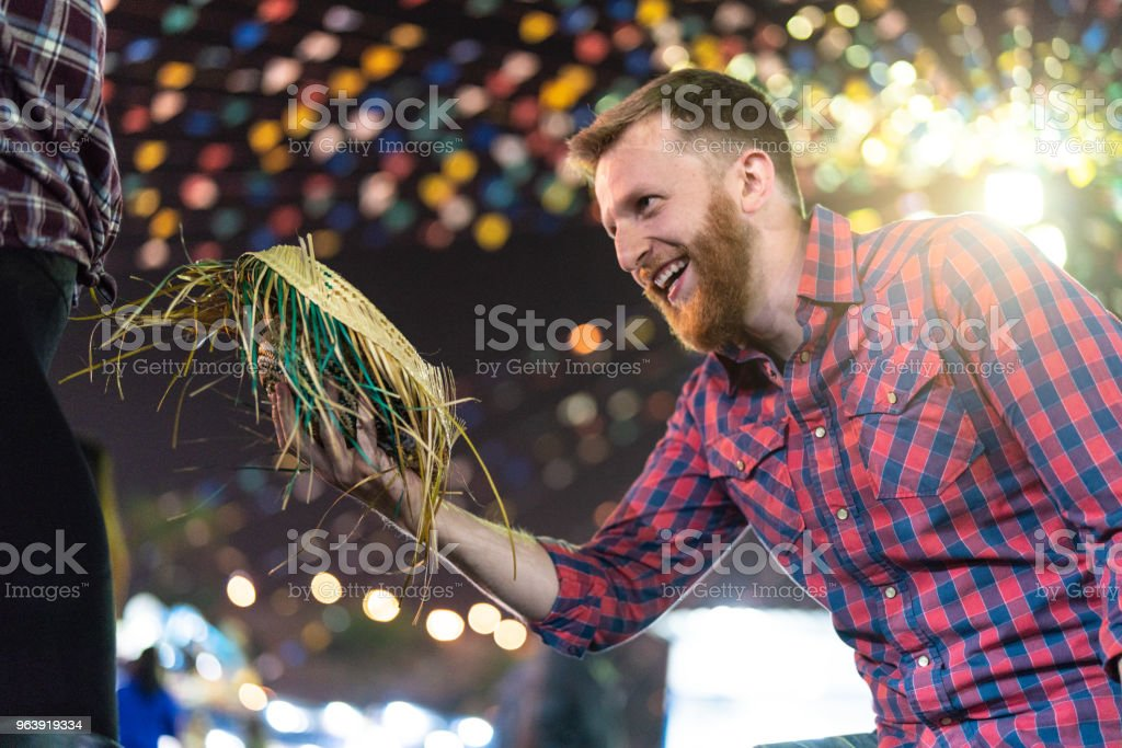 Couple enjoying a great time together in the famous Brazilian Junina Party (Festa Junina) - Dancing Quadrilha - Royalty-free Adult Stock Photo