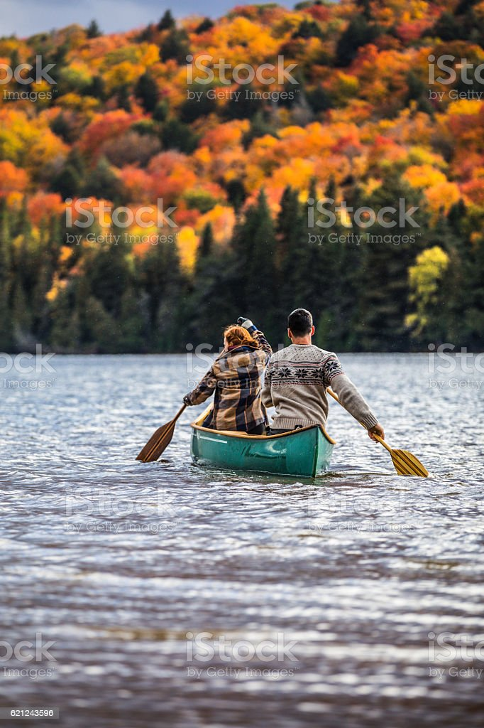 Couple enjoying a ride on a typical canoe in Canada stock photo