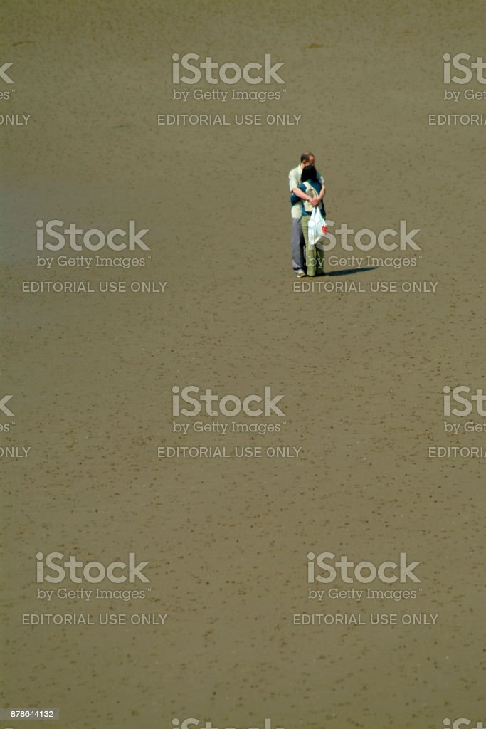 A Couple enjoying a romantic moment on a beach stock photo