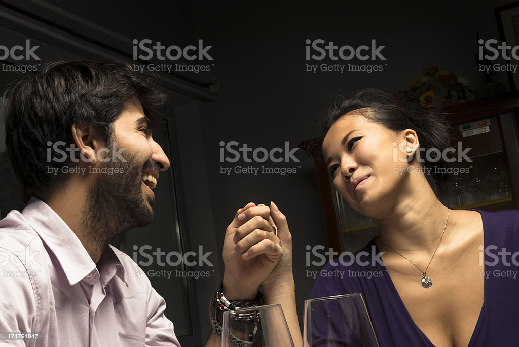Couple enjoying and smiling at restaurant for St. Valentine royalty-free stock photo