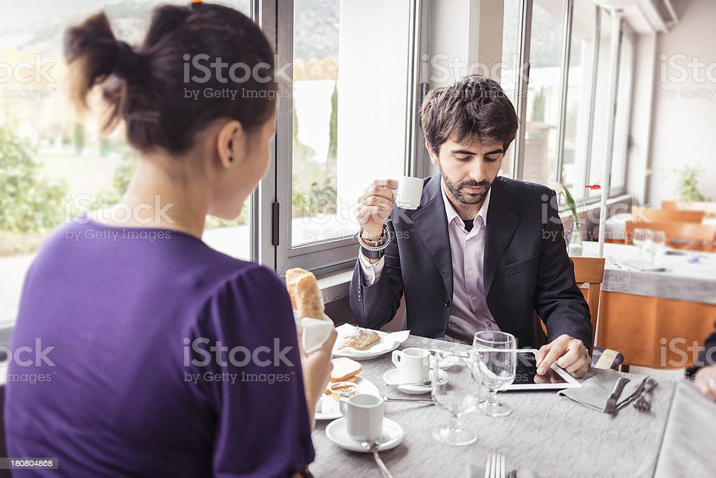 Couple enjoying at breakfast royalty-free stock photo