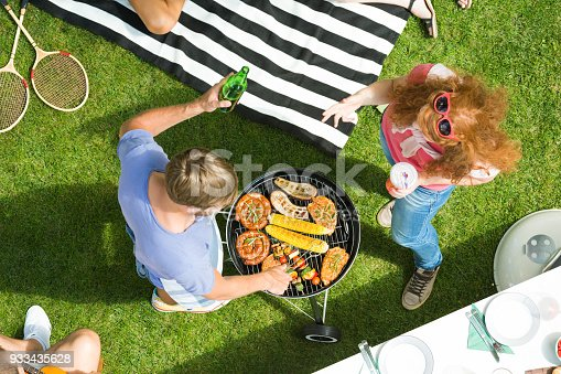 696841580istockphoto Couple enjoying barbecue garden party 933435628
