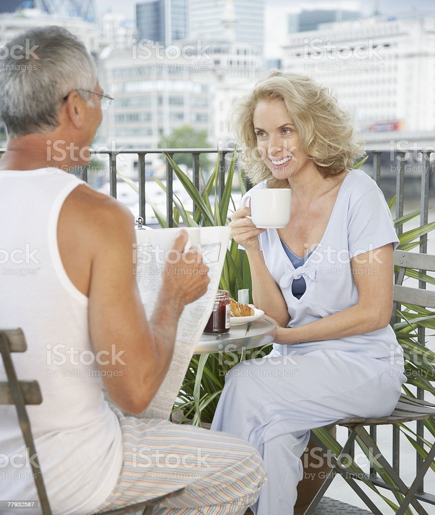 Couple enjoying breakfast on a balcony royalty-free stock photo