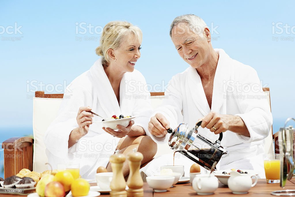 Couple enjoying breakfast royalty-free stock photo