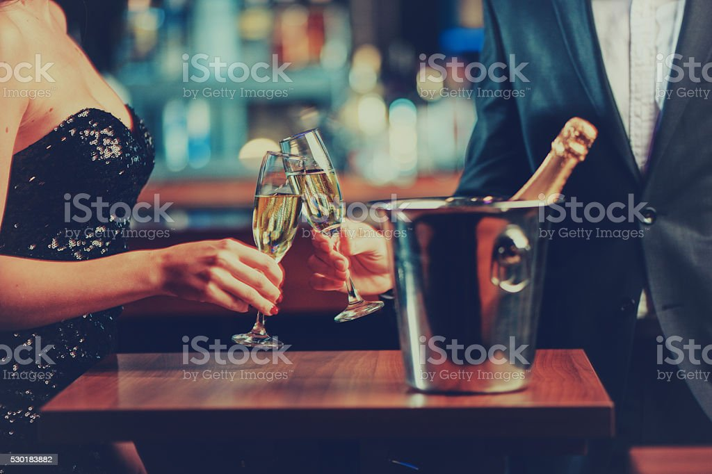 couple enjoying champagne stock photo