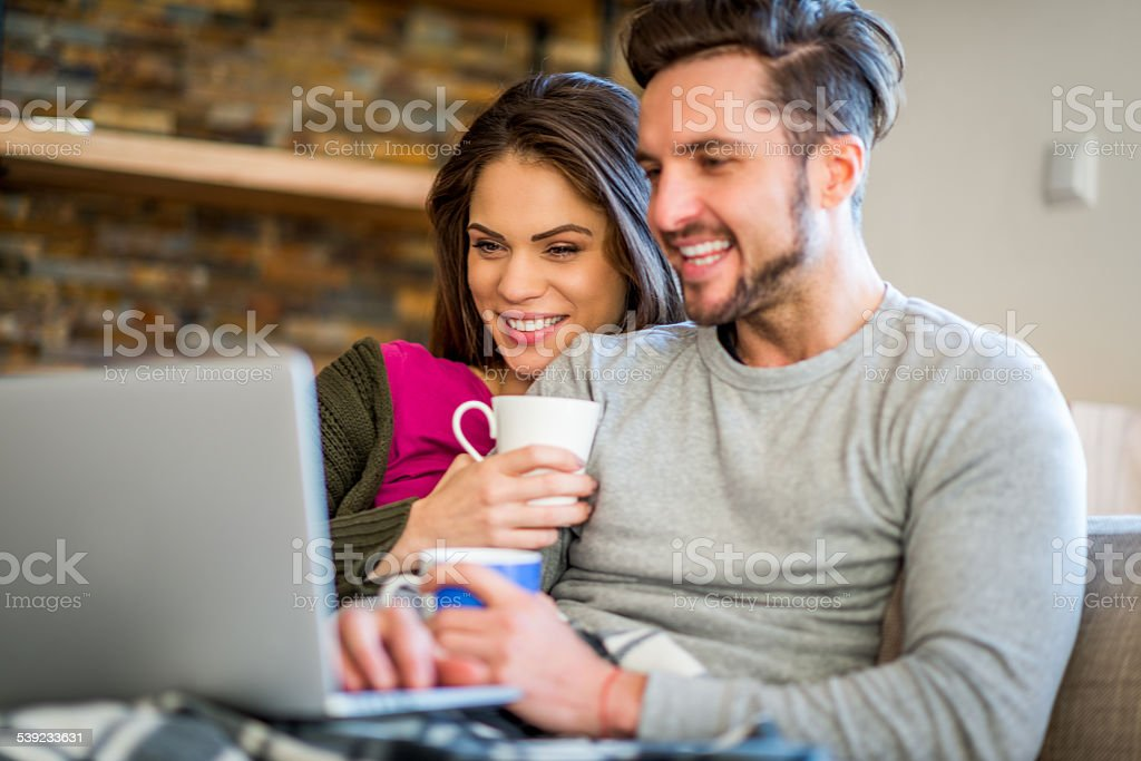 Couple enjoying coffee in bed royalty-free stock photo