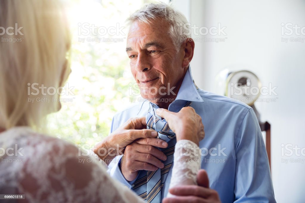 Couple enjoying daily life and retirement. Seniors at Home stock photo