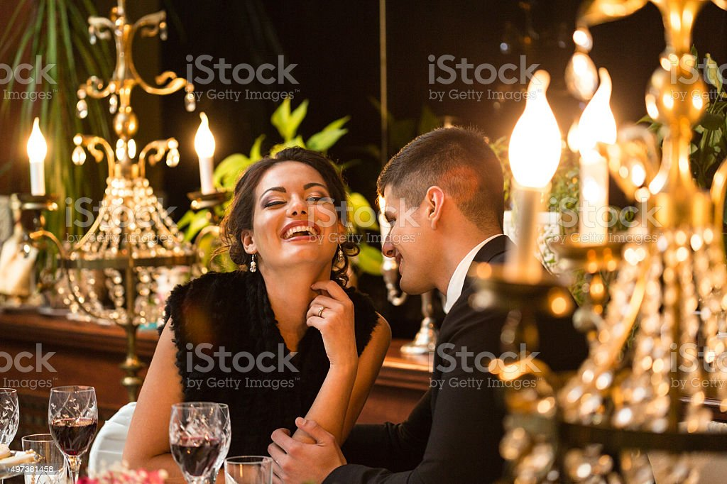Couple enjoying dinner stock photo