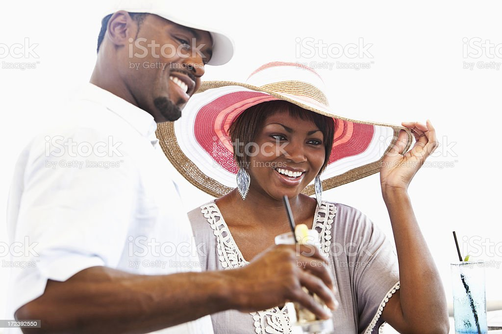 Couple enjoying drinks outdoors royalty-free stock photo
