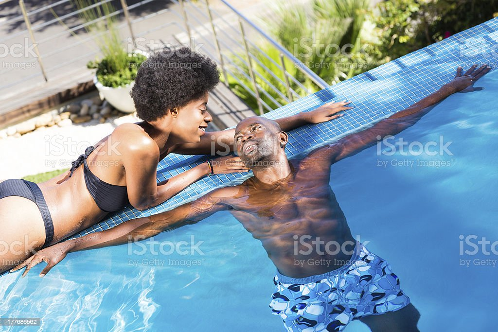 Couple Enjoying Each Other at the Pool stock photo