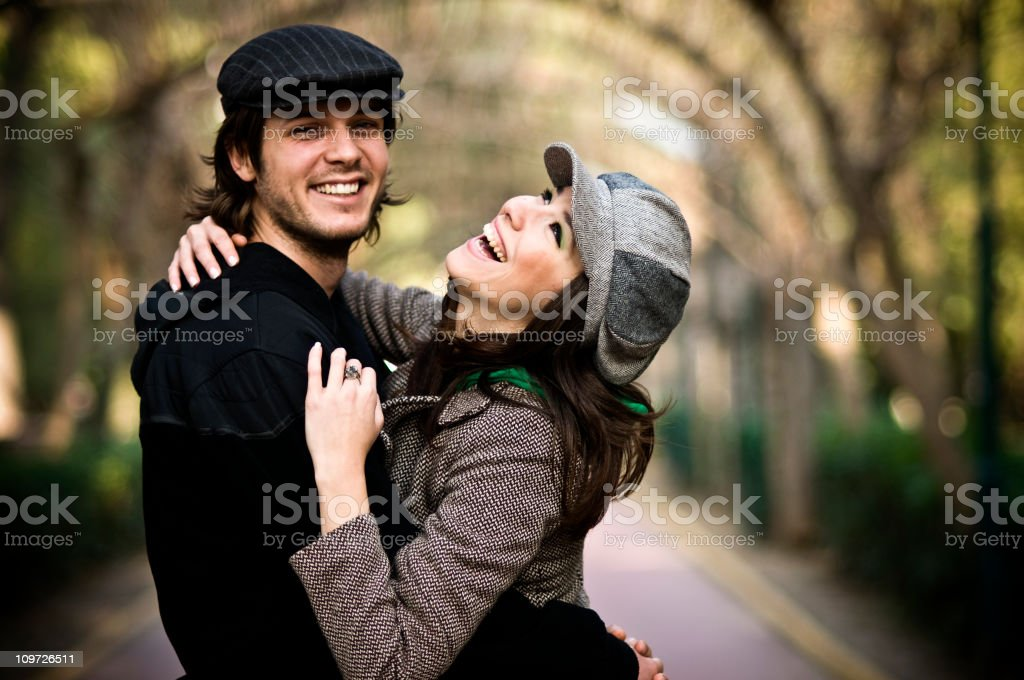 A couple enjoying each other on a walk in the woods royalty-free stock photo