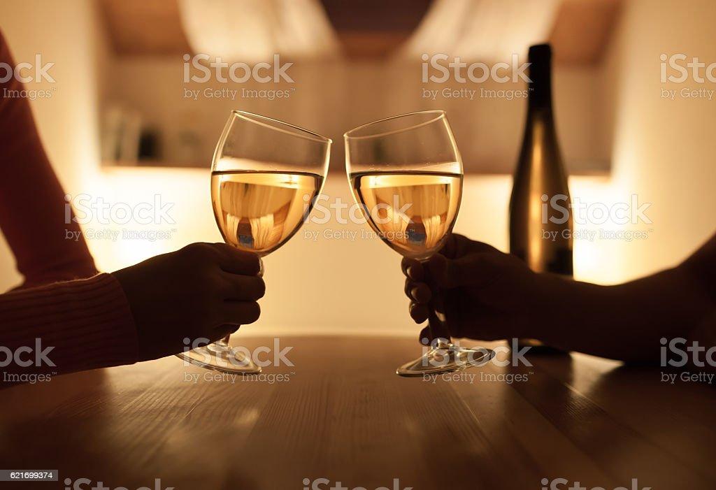 Couple enjoying evening drink stock photo