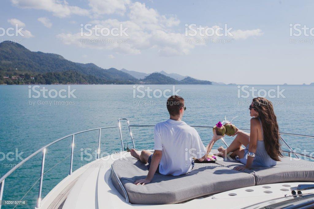 couple enjoying honeymoon onboard of luxury boat, luxurious yacht stock photo