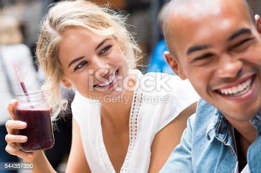 930265372 istock photo Couple enjoying in café 544357330