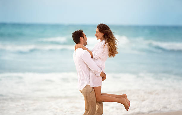 couple enjoying in summer vacation stock photo