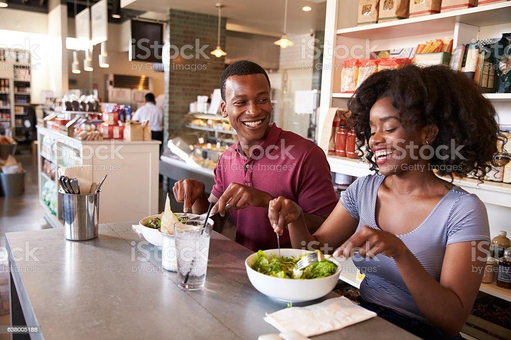 Couple Enjoying Lunch Date In Delicatessen Restaurant - Photo
