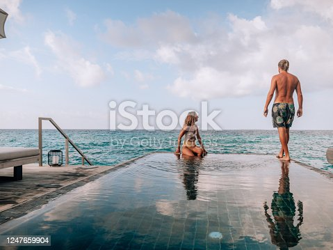 1055009962 istock photo Couple enjoying luxury vacations 1247659904