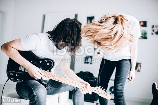 849362192 istock photo Couple enjoying music 849313464
