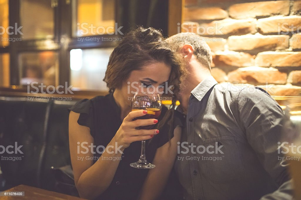Couple Enjoying Night Out At Cocktail Bar stock photo