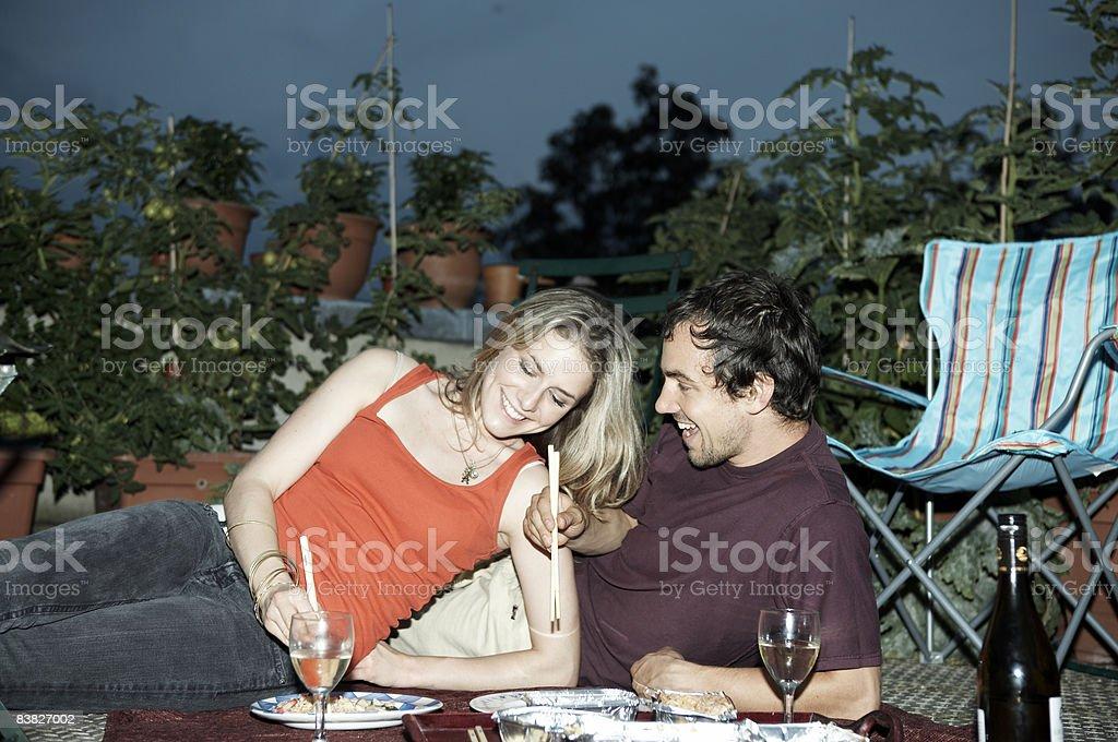 Couple enjoying picnic on rooftop terrace royalty-free stock photo