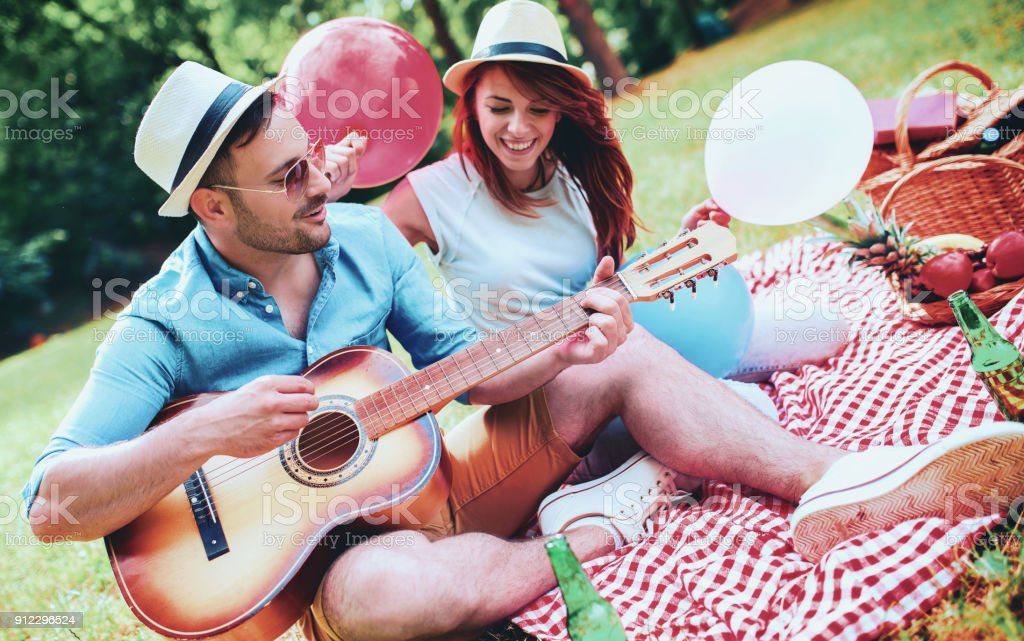 Couple enjoying picnic together. Love and tenderness, dating, romance, lifestyle concept stock photo