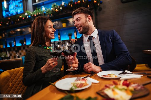 Couple enjoying red wine on Valentine's Day