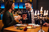 Couple enjoying red wine on Valentine's Day