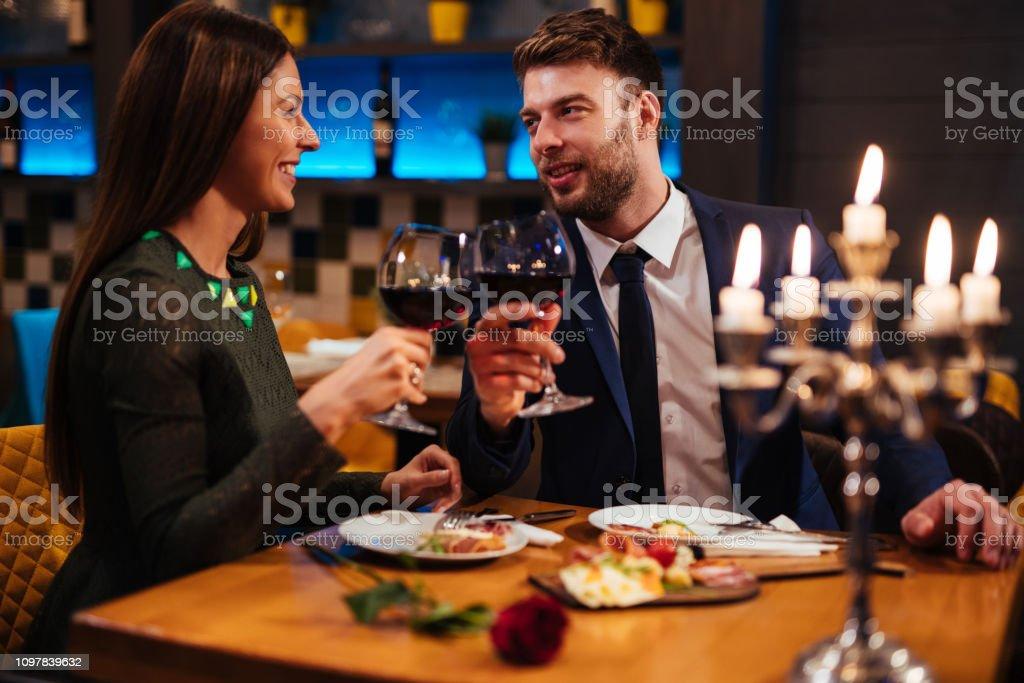 Couple enjoying red wine on Valentine's Day stock photo