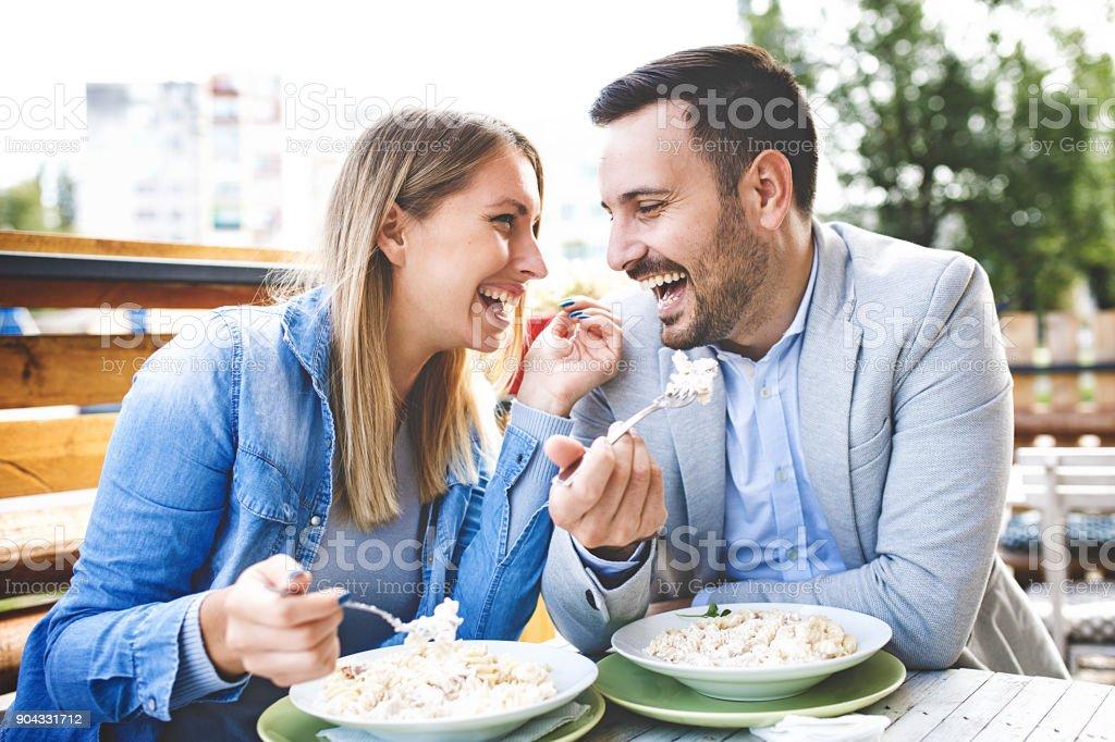 Couple enjoying restaurant stock photo
