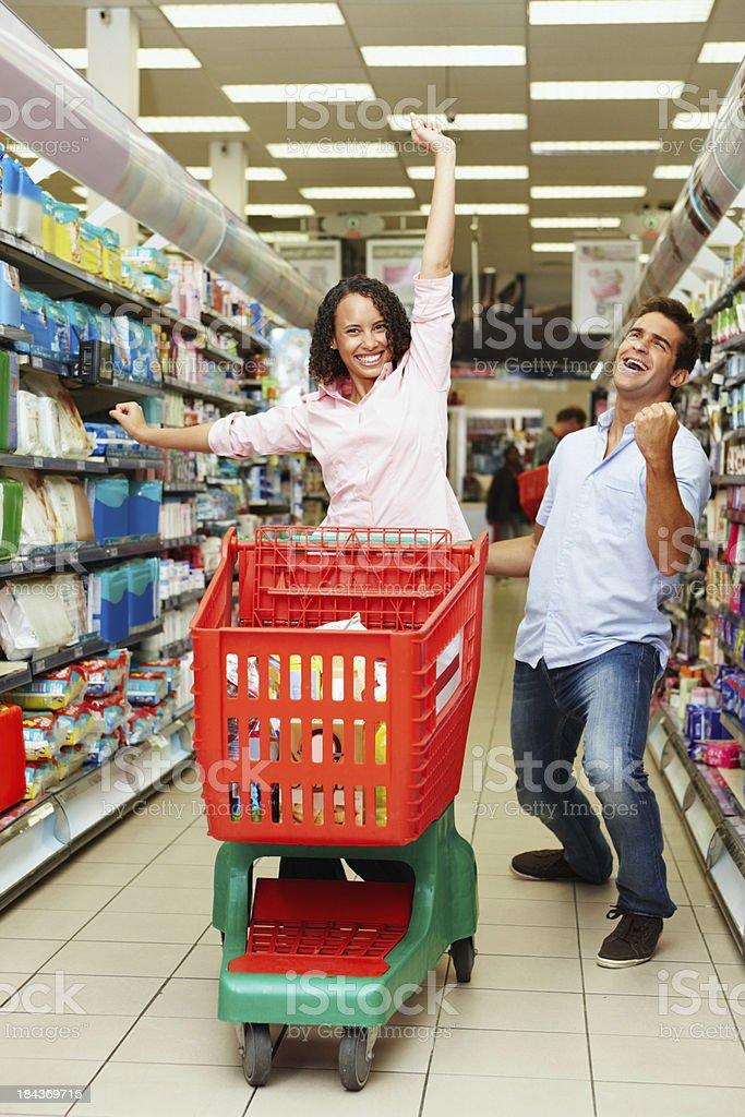 Couple enjoying shopping at super market royalty-free stock photo