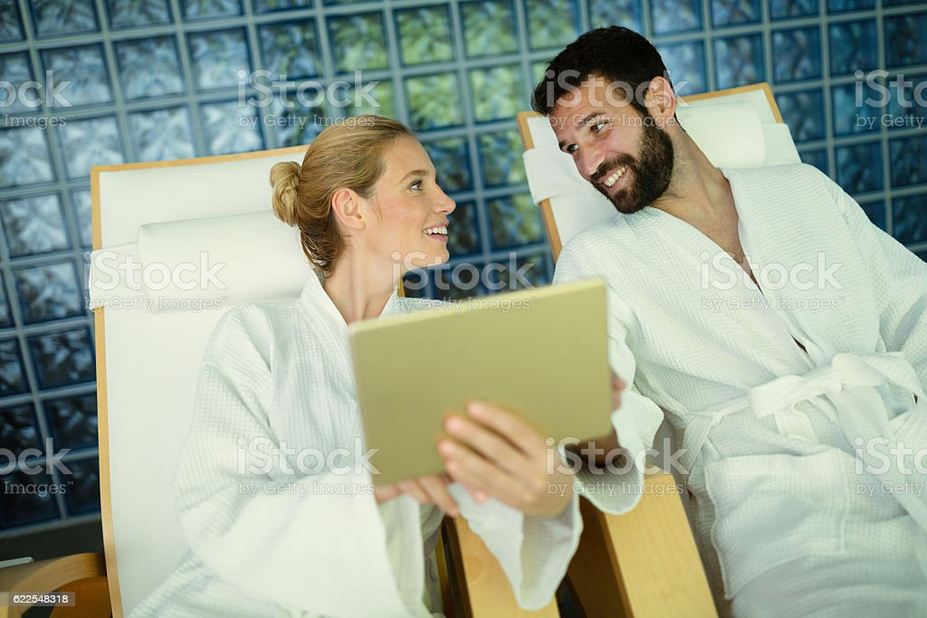 Couple enjoying spa treatments and relaxing stock photo