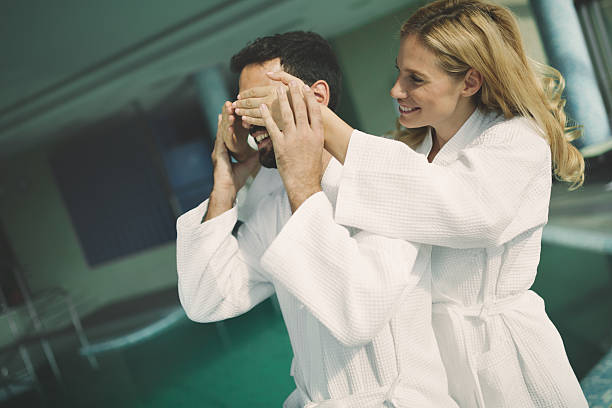 couple enjoying spa wellness treatments - bad date stockfoto's en -beelden