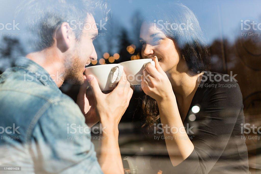 Couple enjoying tea in a restaurant stock photo