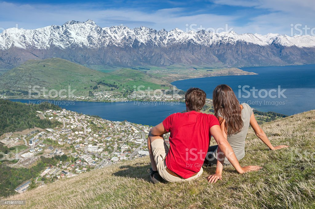 Couple Enjoying the View, Queenstown, New Zealand royalty-free stock photo
