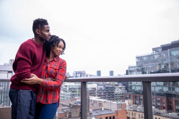 Couple Enjoying Their Balcony View stock photo