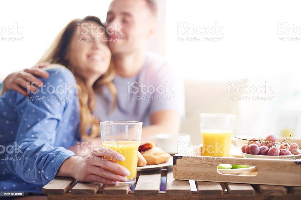 Couple enjoying their breakfast meal together stock photo