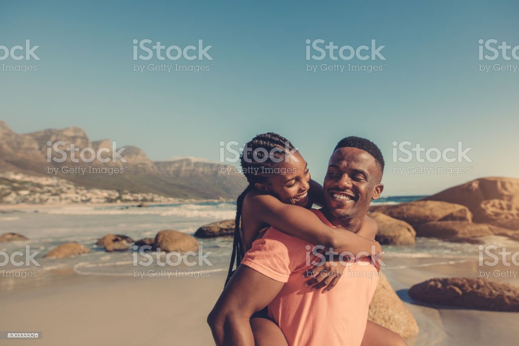 Couple enjoying themselves at the beach stock photo