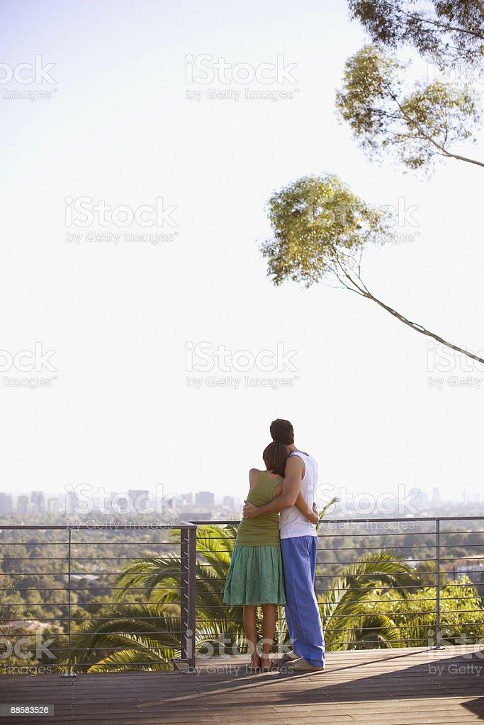 Couple enjoying view from balcony royalty-free stock photo