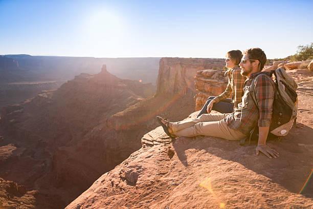 couple enjoying view - moab utah stockfoto's en -beelden
