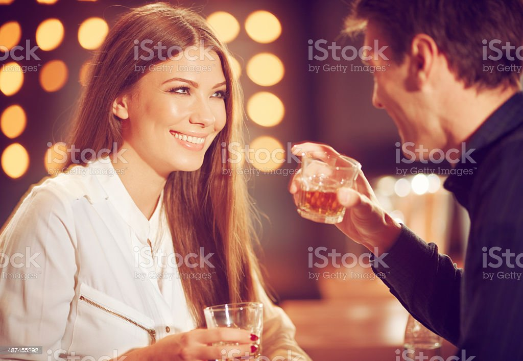 couple enjoying whisky stock photo
