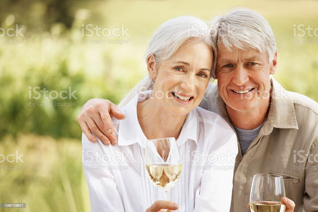 Couple enjoying white wine at the countryside royalty-free stock photo