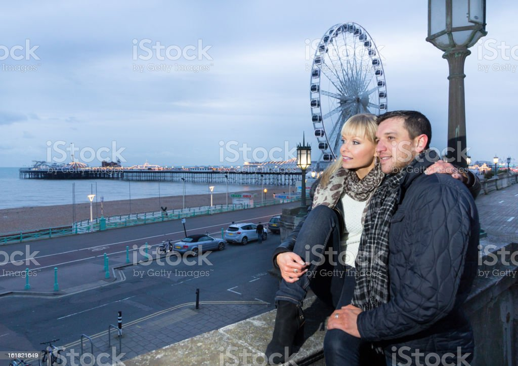 Couple enjoying winter break in Brighton royalty-free stock photo