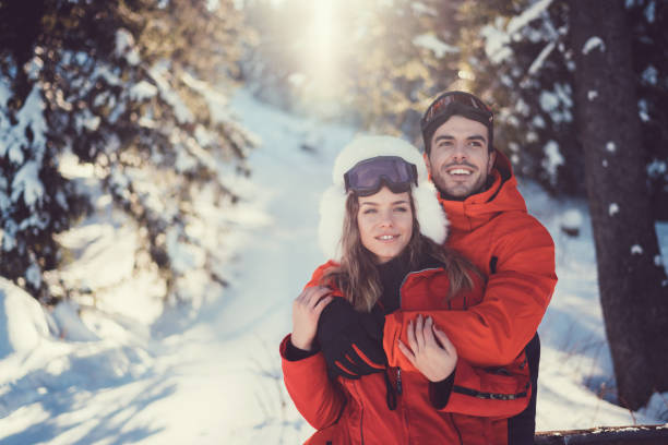 Couple enjoying winter holiday together Smiling couple spending time together at ski holiday ski holiday stock pictures, royalty-free photos & images