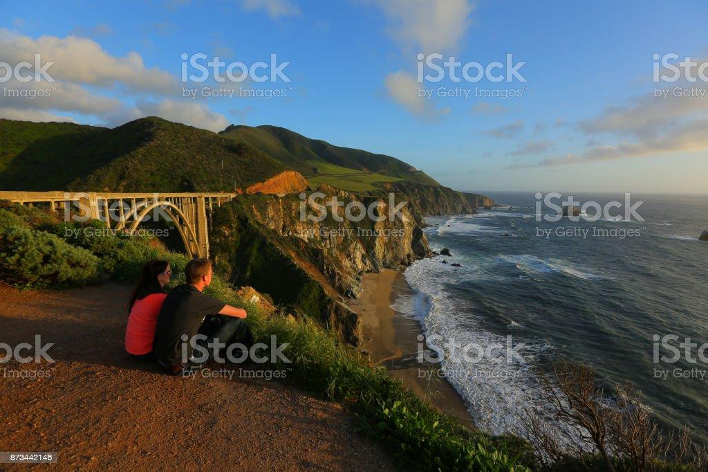 couple enjoys the ocean view stock photo