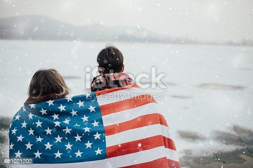 Couple enveloped American flag